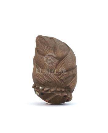 JAPANESE INLAID WOOD NETSUKE In the form of a bamboo shoot