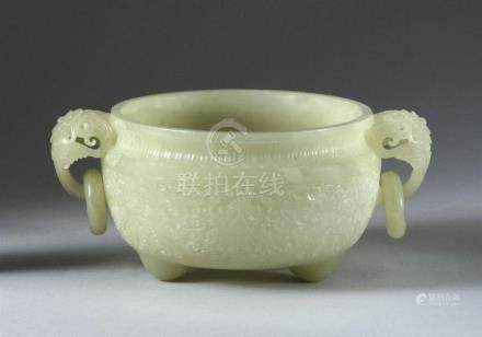 CHINESE CELADON JADE HANDLED BOWL In Mogul style. With openw