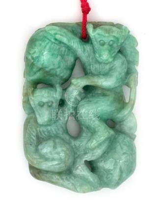 CHINESE GREEN JADEITE PENDANT In the form of two monkeys wit