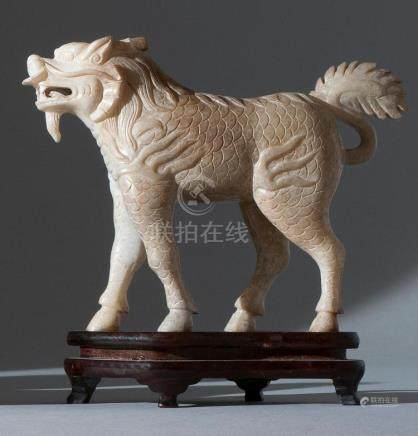 CHINESE CALCIFIED BROWN JADE CARVING In the form of a standi