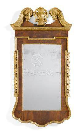 A GEORGE II WALNUT AND PARCEL-GILT MIRROR, SECOND QUARTER 18