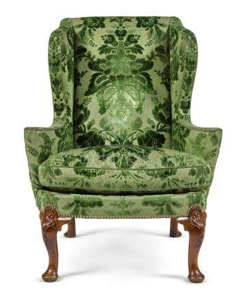 A GEORGE II CARVED WALNUT WING ARMCHAIR, CIRCA 1735 |