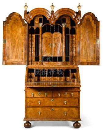 A QUEEN ANNE BURR WALNUT BUREAU CABINET, CIRCA 1710 |