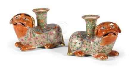 A PAIR OF CHINESE FAMILLE-ROSE 'DOG' CANDLESTICK HOLDER QING