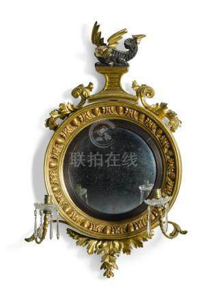 A SMALL REGENCY GILTWOOD AND EBONISED CONVEX MIRROR, EARLY 1
