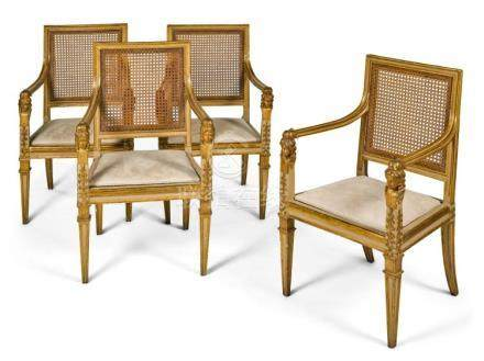 A SET OF FOUR ITALIAN CREAM-PAINTED AND PARCEL-GILT CANED FA