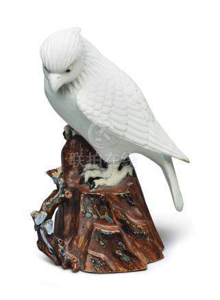 A JAPANESE FIGURE OF A BIRD OF PREY PERCHED ON A STUMP