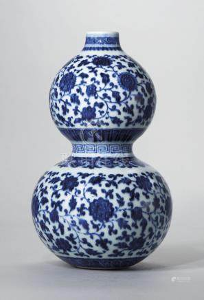 A RARE MING-STYLE BLUE AND WHITE DOUBLE-GOURD VASE