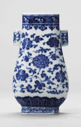 A BLUE AND WHITE MINIATURE VASE, HU
