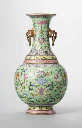A LIME-GREEN GROUND FAMILLE ROSE TWIN-HANDLED VASE