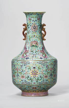 A TURQUOISE-GROUND FAMILLE ROSE TWIN-HANDLED VASE