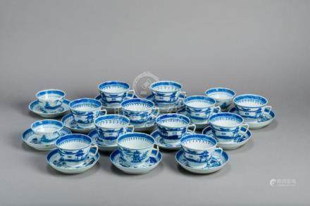 A SET OF 15 BLUE AND WHITE CANTON TEACUPS AND 14 COASTERS