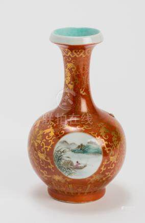 A PORCELAIN VASE PAINTED IN IROD RED AND GOLD