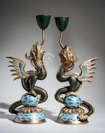 A PAIR OF CLOISONNÉ CANDLESTICKS IN THE FORM OF DRAGON FISH