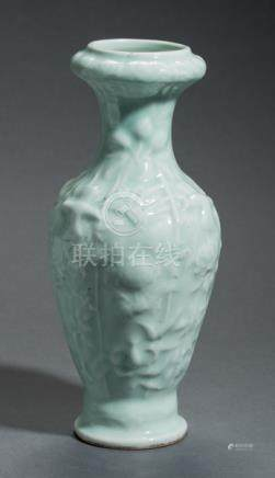 A LONGQUAN GLAZED VASE WITH HIGH RELIEF
