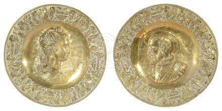 A pair of late Victorian brass chargers,