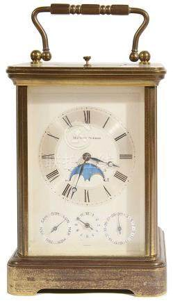A Matthew Norman brass-cased four-dial carriage clock with 'rolling moon phase'