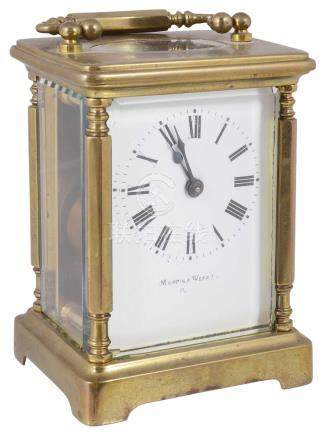 A Mappin & Webb four glass brass carriage clock