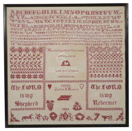 A Victorian needlework sampler by Julia A Moore, dated 1883
