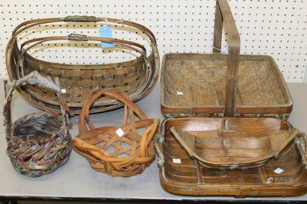 Group of seven Japanese bamboo flower baskets.