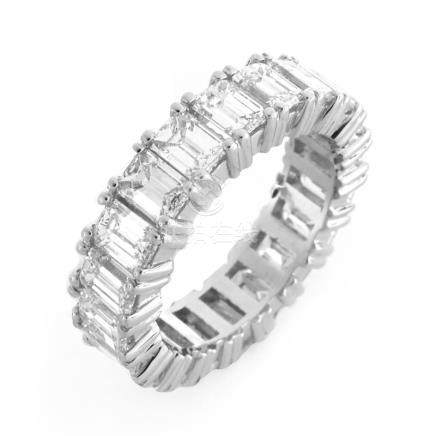 Fine Quality Approx. 6.75 carat Emerald Cut Diamond and Platinum Eternity Band. Diamonds H-I color,