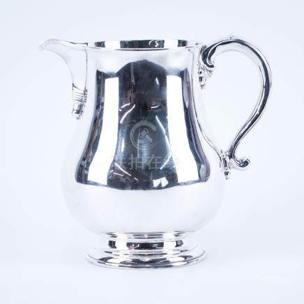 The Goldsmith & Silversmiths Co. English Silver Water Pitcher. Signed and dated London 1935. Good c