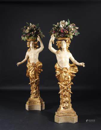 PAIR OF HERMS CARRYING FLOWERS