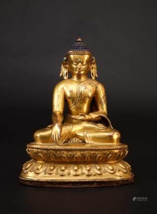 A NEPALESE GILT BRONZE FIGURE OF BUDDHA SHAKYAMUNI