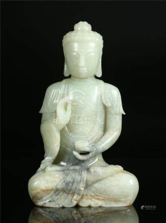 A CHINESE PALE CELADON JADE FIGURE OF BUDDHA