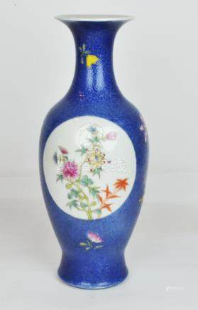 A Chinese Famille Rose Blue Ground Vase