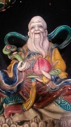 A Glaze Statue of a Fairy Riding a cranc