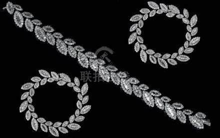 A Superb Quality and Impressive Well Matched 18ct White Gold - Diamond Set Bracelet. Leaf Design,
