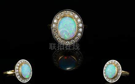 18ct Gold Diamond and Opal Set Dress Ring of Excellent Form. Fully Hallmarked. The Central Cabouchon