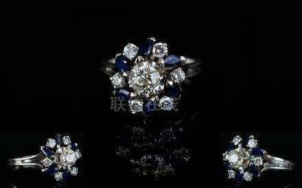 18ct White Gold Diamond and Sapphire Dress Ring, In a Flower head Design Setting. The Diamonds and