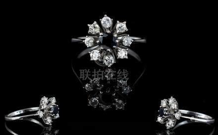 18ct White Gold Diamond and Sapphire Set Dress Ring. Flower head Design. The Central Sapphire
