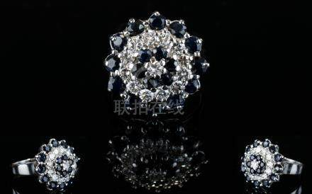 18ct White Gold Sapphire and Diamond Set Cluster Ring. In a Concentric Flower head Setting (