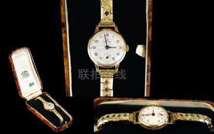 Ladies Certina 18 Gold Cased Wrist Watch with Attached Expanding Gold Plated Bracelet. Features -