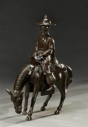 JAPON - Epoque MEIJI (1868 - 1912) Groupe en bronze patiné brun représentant Toba sur sa mule