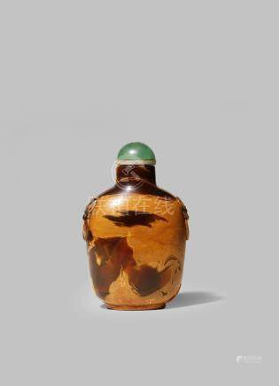 A CHINESE AMBER SNUFF BOTTLE