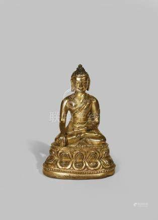 A TIBETAN GILT BRONZE FIGURE OF BUDDHA SAKYAMUNI