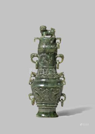 A CHINESE SPINACH-GREEN JADE ARCHAISTIC VASE AND COVER