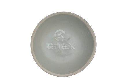 A SONG DYNASTY SMALL CÉLADON-GLAZED 'TWIN FISH' DISH<br><br><br>