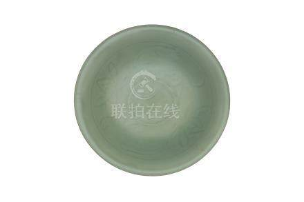 A SONG DYNASTY LONGQUAN CÉLADON-GLAZED 'LOTUS' DISH<br><br><br><br>