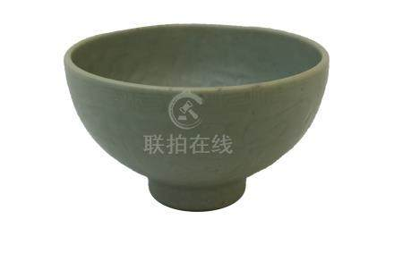 A MING DYNASTY LONGQUAN CÉLADON-GLAZED MOULDED BOWL<br>15th century<br><br><br><br>