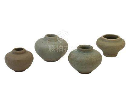 FOUR MING DYNASTY SMALL CÉLADON-GLAZED JARLETS<br>Ming dynasty<br>14th-15th century<br>