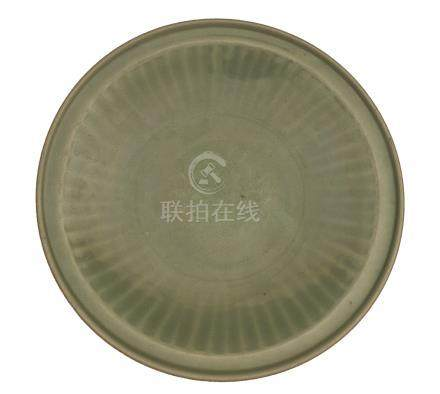 A MING DYNASTY LONGQUAN CÉLADON-GLAZED 'PEONY' CARVED DISH<br>14th-15th century<br><br>