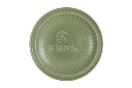 A MING DYNASTY LARGE LONGQUAN CÉLADON-GLAZED 'PEONY' CARVED DISH<br>14th-15th century<br><br>