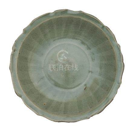 A YUAN/ MING CÉLADON-GLAZED DISH WITH BARBED RIM<br>14th century<br>