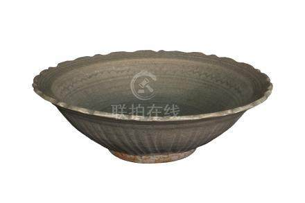 A SAWANKHALOK CÉLADON-GLAZED DISH WITH BARBED RIM<br>14th-16th century<br><br>