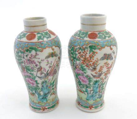 A pair of Chinese Cantonese baluster vases,